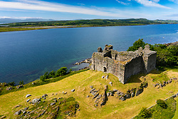 Aerial view from drone of Castle Sween in shore of Loch Sween in Argyll & Bute, Scotland, UK