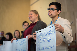 1 December 2019, Madrid, Spain: Lutheran World Federation delegate Sebastian Ignacio Muñoz Oyarzo from the Evangelical Lutheran Church in Chile holds a sheet of paper on which key discussion points have been summarized, as representatives of various faiths gather in the Iglesia de Jesús (Church of Christ) of the Iglesia Evangélica Española (Evangelical Church of Spain) for an interfaith dialogue and prayer service on the eve of the United Nations climate conference (COP25) in Madrid, Spain.