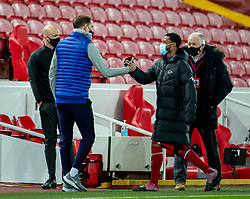 LIVERPOOL, ENGLAND - Thursday, March 4, 2021: Chelsea's manager Thomas Tuchel (L) and Liverpool's Georginio Wijnaldum before the FA Premier League match between Liverpool FC and Chelsea FC at Anfield. Chelsea won 1-0 condemning Liverpool to their fifth consecutive home defeat for the first time in the club's history. (Pic by David Rawcliffe/Propaganda)