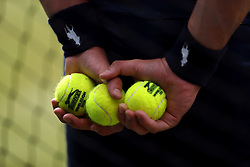 A ball boy holds a set of balls on day one of the Wimbledon Championships at the All England Lawn Tennis and Croquet Club, Wimbledon.