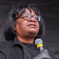 © Licensed to London News Pictures. 21/03/2015. Trafalgar Square, London UK. Diane Abbott MP on stage addressing the large crowds assembled in Trafalgar Square for the Stand Up to Racism and Fascism rally. Photo credit : Stephen Chung/LNP
