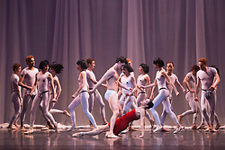© Licensed to London News Pictures. 18/03/2015. London, England. Pictured: Dress rehearsal of Carmina burana, music by Carl Orff with choreography by David Bintley. Section: The Court of Love with Iain Mackay as Sick with Love and Arancha Baselga, Ruth Brill, Reina Fuchigami, Jade Heusen, Yvette Knight, Delia Mathews, Karla Doorbar, Emily Smith and Alys Shee as Tarts. Birmingham Royal Ballet celebrates its 25th anniversary in 2015 with performances of Serenade and Carmina Burana at London Coliseum, 19-21 March 2015. Photo credit: Bettina Strenske/LNP