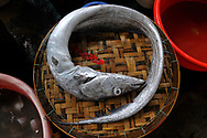 Fish displayed on bamboo basket in a market of Nha Trang, Vietnam, Southeast Asia