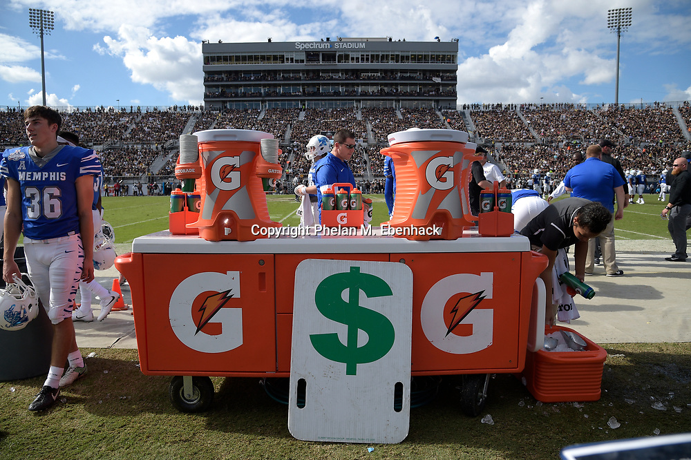 Gatorade containers sit next to the Memphis bench during the first half of the American Athletic Conference championship NCAA college football game against Central Florida Saturday, Dec. 2, 2017, in Orlando, Fla. (Photo by Phelan M. Ebenhack)