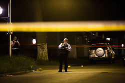 April 24, 2017 - Chicago, IL, USA - Chicago police officers investigate the area where two people were shot in the 6900 block of South Honore Street on April 24, 2017, in Chicago, Ill. (Credit Image: © Armando L. Sanchez/TNS via ZUMA Wire)