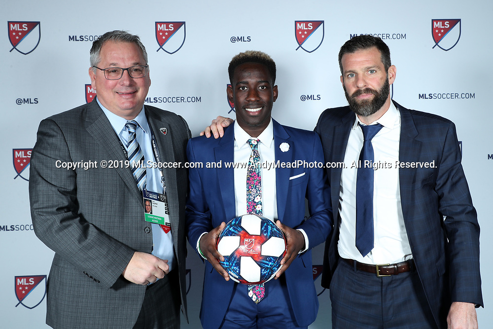 CHICAGO, IL - JANUARY 11: Akeem Ward was taken with the fourteenth overall pick by DC United. With general manager Dave Kaspar (left) and head coach Ben Olsen (right). The MLS SuperDraft 2019 presented by adidas was held on January 11, 2019 at McCormick Place in Chicago, IL.