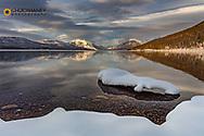 Mountain peaks reflect in Lake McDonald in winter in Glacier National Park, Montana, USA
