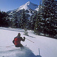 Skiing, Big Sky, MT.  Powder skier  in upper Africa Bowl.  Lone Mountain, bkg.  <br /> (Sinuhe Shrecengost (MR)).
