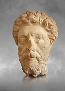 Roman sculpture of the Emperor Marcus Aurelius, excavated  from Carthage made circa 161-180 AD. The Bardo National Museum, Tunis, Inv No: C.965. Against a grey art background. .<br /> <br /> If you prefer to buy from our ALAMY STOCK LIBRARY page at https://www.alamy.com/portfolio/paul-williams-funkystock/greco-roman-sculptures.html . Type -    BARDO    - into LOWER SEARCH WITHIN GALLERY box - Refine search by adding a subject, place, background colour, museum etc.<br /> <br /> Visit our CLASSICAL WORLD HISTORIC SITES PHOTO COLLECTIONS for more photos to download or buy as wall art prints https://funkystock.photoshelter.com/gallery-collection/The-Romans-Art-Artefacts-Antiquities-Historic-Sites-Pictures-Images/C0000r2uLJJo9_s0c