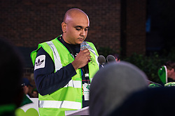 London, UK. 14 June, 2019. Zeyad Cred, organiser of the Grenfell Silent Walk, reads out the names of members of the Grenfell community who lost their lives in the Grenfell Tower fire following the Grenfell Silent Walk on the second anniversary of the tragedy. 72 people died and over 70 were injured in the Grenfell Tower fire.