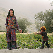 Mother and grand son. What they wear is all home made, and parents often pin some kind of small talisman to the kid's jacket – you can see it here on the left. There can be a piece of the Koran, this will protect kids against the evil eye. The traditional life of the Wakhi people, in the Wakhan corridor, amongst the Pamir mountains.
