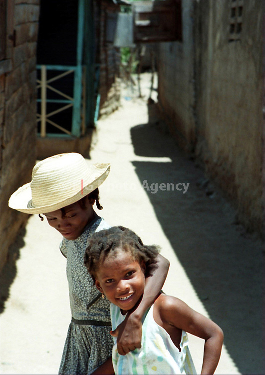 Couple of Haitian girls walking on the streets at Ouanaminthe.