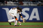 San Francisco Giants shortstop Brandon Crawford (35) fields a ground ball with his bare hand against the Milwaukee Brewers at AT&T Park in San Francisco, California, on August 21, 2017. (Stan Olszewski/Special to S.F. Examiner)