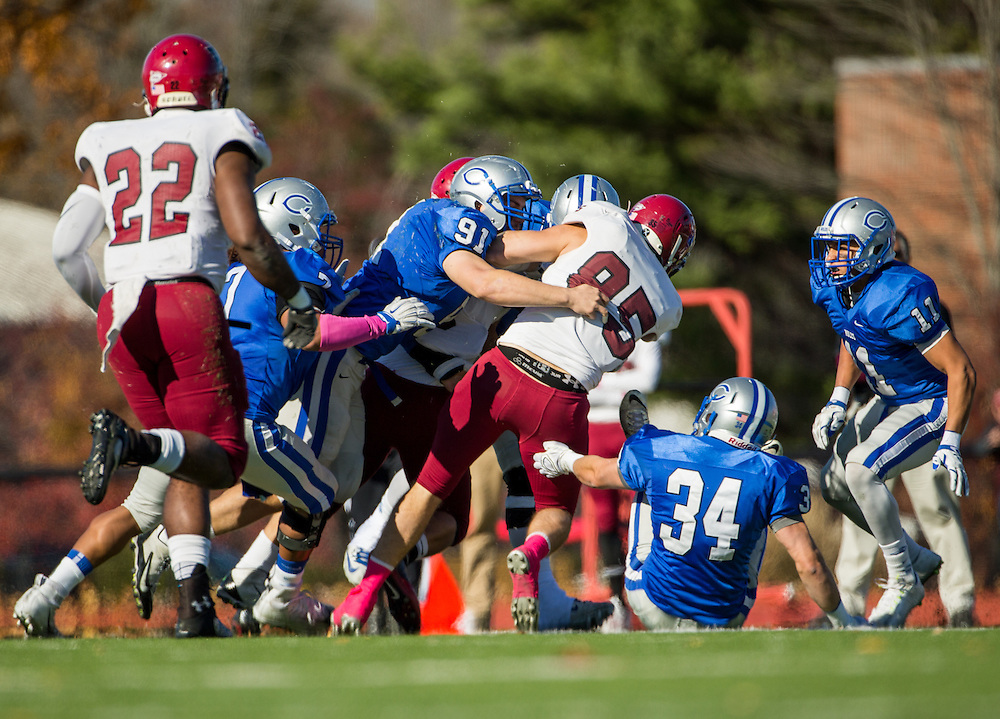 Colby College linebacker Stephen O'Grady (91) tackles Bates College wide receiver Mark Riley (85) during a NCAA Division III football game between Colby College and Bates College at Seaverns Field at Harold Alfond Stadium on October 24, 2015 in Waterville, Maine. (Dustin Satloff)