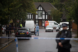 © Licensed to London News Pictures.  02/10/2021. London, UK. Police guard a crime scene after the 35-year-old man been shot to death after leaving the house party in Croydon, south London. Police were called to reports of a man being wounded shortly before 5am.  Photo credit: Marcin Nowak/LNP