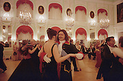 Saint Petersburg, Russia, June 2002..Dancing in the Throne Room at Peterhof Palace at the Stars of the White Nights midsummer ball. The mid-summer White Nights period when the sun sets only briefly is a time of festivals, entertainment and walks along the Neva River to watch the city bridges raise for shipping..