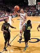 Dec. 17, 2010; Charlottesville, VA, USA; Virginia Cavaliers guard Mustapha Farrakhan (2) shoots over Oregon Ducks forward Jeremy Jacob (23) and Oregon Ducks guard Teondre Williams (22) during the first half of the game at the John Paul Jones Arena. Mandatory Credit: Andrew Shurtleff