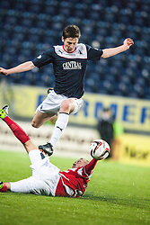 Falkirk's Conor McGrandles tackled by Hamilton's Grant Gillespie.<br /> Falkirk 0 v 0 Hamilton, Scottish Championship game at The Falkirk Stadium. © Michael Schofield 2014.