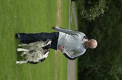 Eddie Sander with his Dogs Jackson and Inka<br /><br />18 June 2004<br /><br />Copyright Paul David Drabble<br /> [#Beginning of Shooting Data Section]<br />Nikon D1 <br /> Focal Length: 80mm<br /> Optimize Image: <br /> Color Mode: <br /> Noise Reduction: <br /> 2004/06/18 09:40:10.1<br /> Exposure Mode: Manual<br /> White Balance: Auto<br /> Tone Comp: Normal<br /> JPEG (8-bit) Fine<br /> Metering Mode: Center-Weighted<br /> AF Mode: AF-S<br /> Hue Adjustment: <br /> Image Size:  2000 x 1312<br /> 1/200 sec - F/7.1<br /> Flash Sync Mode: Not Attached<br /> Saturation: <br /> Color<br /> Exposure Comp.: 0 EV<br /> Sharpening: Normal<br /> Lens: 80-200mm F/2.8<br /> Sensitivity: ISO 200<br /> Image Comment: <br /> [#End of Shooting Data Section]