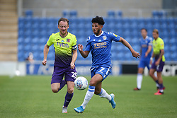 Courtney Senior of Colchester United runs with the ball under pressure from Jake Taylor of Exeter City - Mandatory by-line: Arron Gent/JMP - 18/06/2020 - FOOTBALL - JobServe Community Stadium - Colchester, England - Colchester United v Exeter City - Sky Bet League Two Play-off 1st Leg