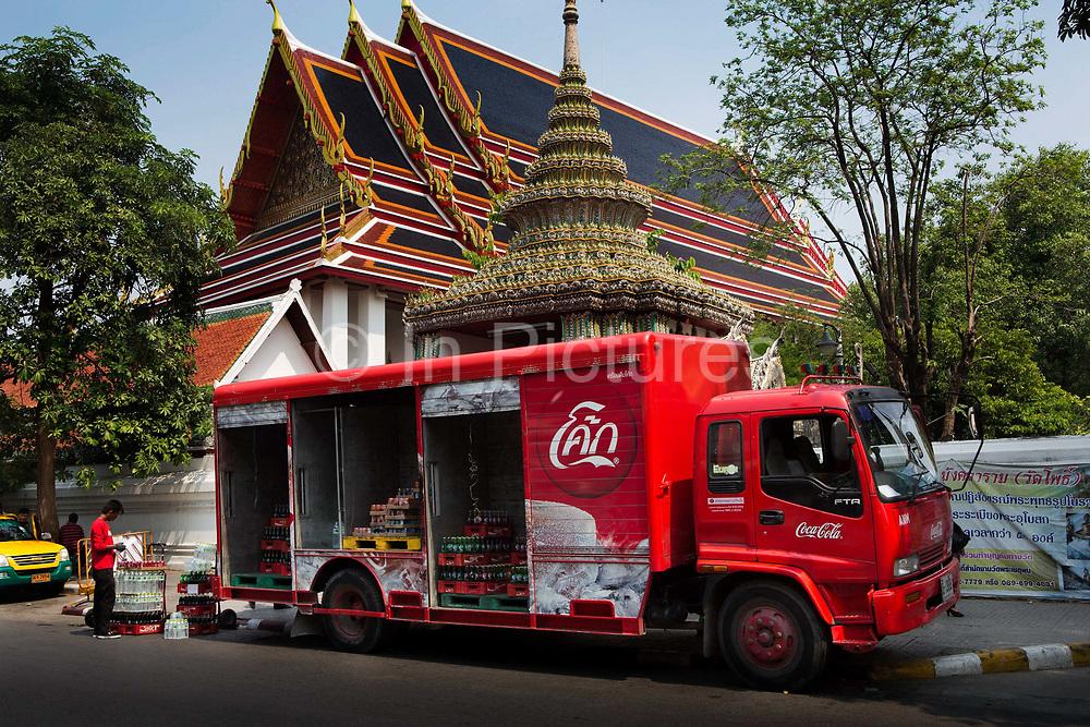 Coca cola truck unloading outside Wat Pho temple, Bangkok, Thailand.