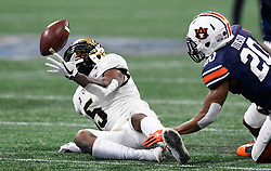 UCF Knights wide receiver Dredrick Snelson (5) can't make the reception under pressure from Auburn Tigers defensive back Jeremiah Dinson (20) during the Chick-fil-A Peach Bowl NCAA college football game January 1, 2018, in Atlanta. (David Tulis via Abell Images for Chick-fil-A Peach Bowl)