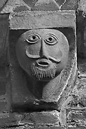 The Stone Bestiary - Black and white photo art print of Norman Romanesque exterior corbel no 31 - sculpture of a man with a goatee beard. The Norman Romanesque Church of St Mary and St David, Kilpeck Herefordshire, England. Built around 1140 .<br /> <br /> Visit our LANDSCAPE PHOTO ART PRINT COLLECTIONS for more wall art photos to browse https://funkystock.photoshelter.com/gallery-collection/Places-Landscape-Photo-art-Prints-by-Photographer-Paul-Williams/C00001WetsxVxNTo
