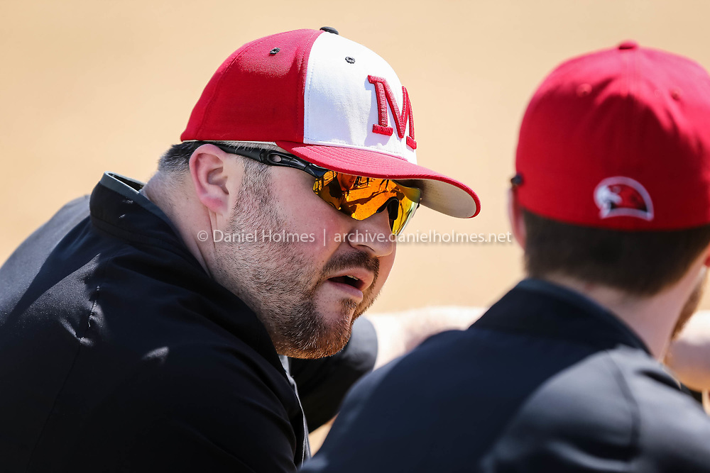 (4/13/17, FRANKLIN, MA) Milford softball coach Steve DiVitto speaks with his players before a game against Franklin at Franklin High School on Thursday. [Daily News and Wicked Local Photo/Dan Holmes]