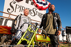 Sons of Speed racer Freddie Bollwage with Carey Maynell beside Carey's 1927 Harley-Davidson board track racer in the  the Spirit of Sturgis races at the fairgrounds during the Sturgis Black Hills Motorcycle Rally. Sturgis, SD, USA. Monday, August 5, 2019. Photography ©2019 Michael Lichter.