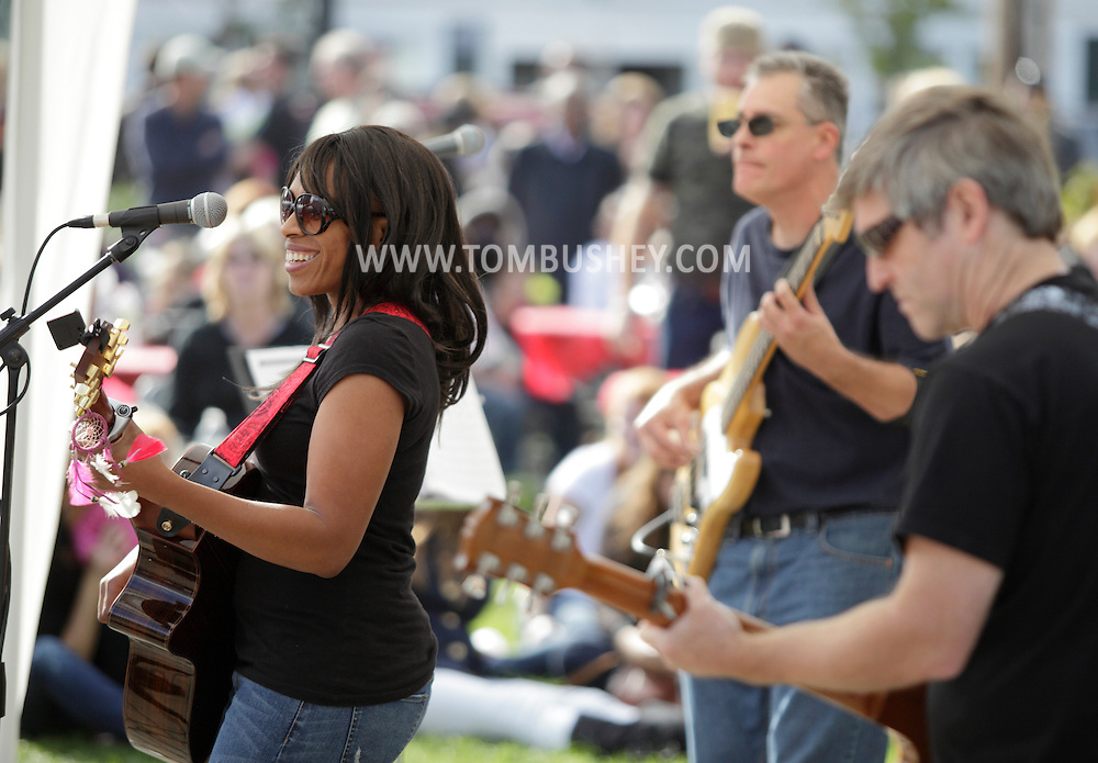 Warwick, New York - E'lissa Jones sings and plays guitar in a park during the Applefest harvest celebration on Oct. 3, 2010.