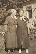 1937 vintage photograph of two elderly woman posing for a picture