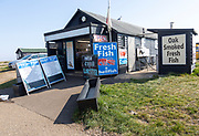 Beach fishmonger shop selling fresh and smoked fish, Aldeburgh, Suffolk, England, UK