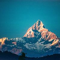 Machhapuchhare Peak towers above the Pokhara Valley in the Nepal Himalaya.