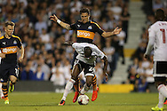 Daryl Janmaat of Newcastle United fouls Sone Aluko of Fulham. Skybet EFL championship match, Fulham v Newcastle Utd at Craven Cottage in Fulham, London on Friday 5th August 2016.<br /> pic by John Patrick Fletcher, Andrew Orchard sports photography.