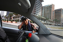 Hadi, 14, a Palestinian, sells lottery tickets and gum in front of the five-star Phonecia Intercontinental Hotel, Beirut, Lebanon, March 28, 2006. Less than one block away, former Lebanese Prime Minister Rafik Hariri was assassinated in 2004. Hadi, who has been working at this location for years, witnessed the event and was thrown into the air when the car bomber exploded into Hariri's convoy.