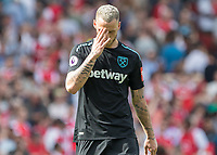 Football - 2017 / 2018 Premier League - Arsenal vs. West Ham United<br /> <br /> West Ham goal scorer Marko Arnautovic (West Ham United) tries to hide his emotions at the end of the game at The Emirates.<br /> <br /> COLORSPORT/DANIEL BEARHAM