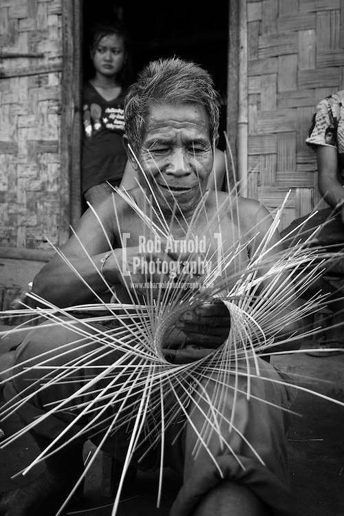 A 76-year old man weaves bamboo in a village near Nong Khiaw in Northern Laos