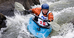 Piper Wall of Ames, Iowa races in the K1 women's master plastic class during the slalom course of the 42nd Annual Missouri Whitewater Championships. Wall placed second place in the class. The Missouri Whitewater Championships, held on the St. Francis River at the Millstream Gardens Conservation Area, is the oldest regional slalom race in the United States.