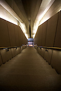 A study of partial symmetry in one of the many stairways at the Sydney Opera House. Working with only the recessed light provided.