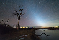 I don't think I've ever seen the zodiacal light glow this prominently before. As soon as it became dark enough it jumped out at me right away. The ghostly glow is caused by the sun illuminating dust within our solar system. The glow extends diagonally along the path of the ecliptic, also known as the zodiac. Only under very dark skies like this spot near St Xavier, Montana, are views like this possible.