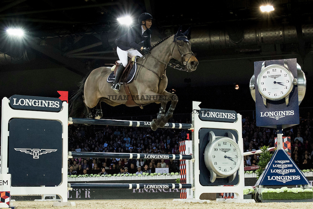 Jane Richard Philips on Dieudonne de Guldenboom competes during Longines Grand Prix at the Longines Masters of Hong Kong on 21 February 2016 at the Asia World Expo in Hong Kong, China. Photo by Juan Manuel Serrano / Power Sport Images