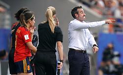 Spain head coach Jorge Vilda (right) speaks to his team