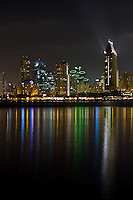 Downtown San Diego City skyline as it lights up the bay and water at night. Viewed from Coronado.