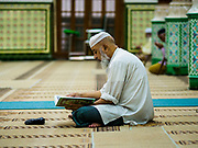"24 NOVEMBER 2017 - YANGON, MYANMAR: Men pray in Surtee Sunni Jumma Mosque in Yangon. Many Muslims in overwhelmingly Buddhist Myanmar feel their religion is threatened by a series of laws that target non-Buddhists. Under the so called ""Race and Religion Protection Laws,"" people aren't allowed to convert from Buddhism to another religion without permission from authorities, Buddhist women aren't allowed to marry non-Buddhist men without permission from the community and polygamy is outlawed. Pope Francis is to arrive in Myanmar next week and is expected to address the persecution of the Rohingya, a Muslim ethnic minority in western Myanmar. Some Muslims and Christians are concerned that if the Pope's comments take too strong of pro-Rohingya stance, he could exacerbate religious tensions in the country.  PHOTO BY JACK KURTZ"