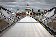 View looking across Millennium Bridge towards St Pauls Cathedral is eerily quiet and silent aside from a few pedestrians on empty streets as lockdown continues and people observe the stay at home message in the capital on 11th May 2020 in London, England, United Kingdom. Coronavirus or Covid-19 is a new respiratory illness that has not previously been seen in humans. While much or Europe has been placed into lockdown, the UK government has now announced a slight relaxation of the stringent rules as part of their long term strategy, and in particular social distancing.