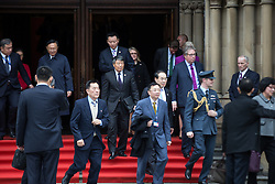 © Licensed to London News Pictures . 23/10/2015 . Manchester , UK . Chinese delegates pour out of Manchester Town Hall , in Albert Square , as Chinese president , Xi Jinping , visits inside as part of his state visit to the United Kingdom . Photo credit: Joel Goodman/LNP