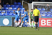 Hartlepool United defender Adam Jackson (26) is congratulated by Hartlepool United defender Jake Carroll (3) after making it 1-0 during the Sky Bet League 2 match between Hartlepool United and AFC Wimbledon at Victoria Park, Hartlepool, England on 25 March 2016. Photo by Stuart Butcher.