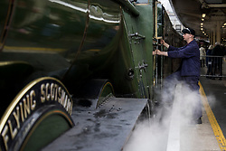 © Licensed to London News Pictures. 20/05/2021. London, UK. A train driver boards the The LNER Flying Scotsman steam locomotive as it prepares to leave Victoria Station in central London ahead of a tour through the Surrey Hills in South east England. The heritage steam locomotive touring season was mostly cancelled last year due to the Covid-19 pandemic but is now underway as restrictions are eased. Built in 1923 for the London and North Eastern Railway (LNER)It was the first steam locomotive to reach 100 miles per hour . Photo credit: Ben Cawthra/LNP