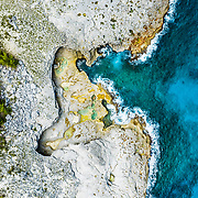 Aerial view of the Queen's Bath along the cliffs of Eleuthera Island, Bahamas.