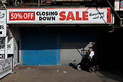 People pass by permanently shuttered businesses amid a wave of high street chain closures brought on by financial strain of the Covid-19 pandemic on 7th September, 2021 in Blackpool, United Kingdom. Despite a rise in footfall across the UKs high streets, new data has shown more than 8,700 chain stores have closed permanently, with the Covid-19 pandemic seeing consumer habits shifting in favour of shopping online or locally.